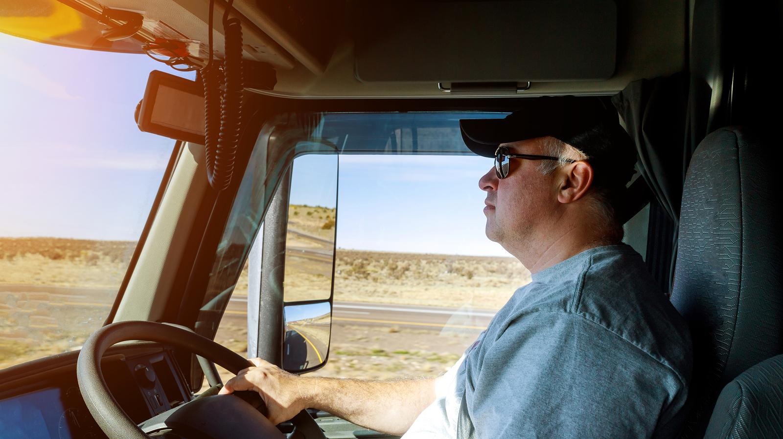 A driver working despite truck driver turnover.